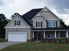 -The SAGE CS-4 Plan in Mamie Belle Ridge with 4 Bedroom 2.5 Bath Foyer with Hardwoods Family Room with Corner Gas Fireplace Master Suite wSitting Area Dual Vanities Seperate. Tub and Shower Large Kitchen with Island and Bar Seating Granite Formal Living and Dining Rooms Sun Room Laundry Room Upstairs