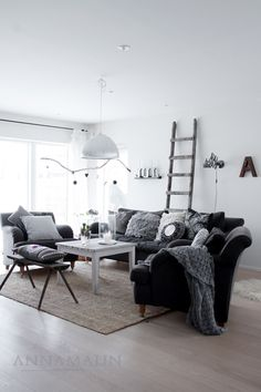 I am loving all the gray pillows on the gray couch!