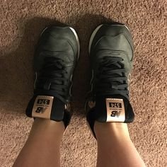 New Balance 574 Dark Grey with Rose Gold Sneakers are in excellent condition, worn a few times, but no wear on the tread. Women's 6.5. Versatile colors - the rose gold is super cute. New Balance Shoes Sneakers