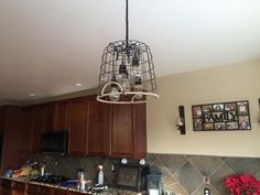 VintageHanging Bulb Farm Basket Light.  Starting at around $100 the possibilities are endless with this design by Ginger Hawk Customs Kitchen Cabinets, Custom Creations, Pendant Light, Home, Light, Bulb, Metal Baskets, Basket Lighting, Home Decor
