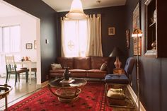 Fulhaus Inc. / Client: Den / Location: Clark & St. Viateur, Mile End, Montreal / Year: 2015 / Living Room  [ moody, dark denim, blue, red, persian rug, leather, cognac, tobacco, teak, bamboo, brass, interior design, interior decor, decorating, home, house, cozy, warm, traditional, classy, luxury, world, travel, bohemian, airbnb, vintage, mid century, masculine, man cave ]