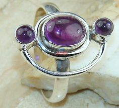 Beautiful item with Amethyst Cabochon Gemstone(s) set in pure 925 sterling silver.