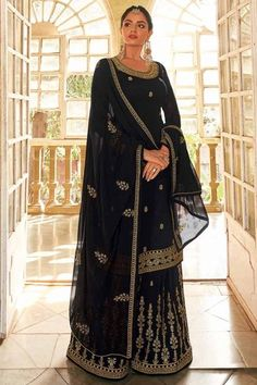 Exuding elegance and finished with perfection, this black georgette sharara suit which surely deserves a special place in your wardrobe. This round neck and full sleeve suit accentuated with stone and zari. Completed with georgette sharara pants in black color with black georgette dupatta. Sharara pants and dupatta are also beautified with stone and zari work. #shararasuits #malaysia #Indianwear #weddingwear #andaazfashion Pakistani Sharara, Sharara Suit, Pakistani Suits, Salwar Kameez, Indian Attire, Indian Wear, Pantalon Cigarette, Modest Wear, Georgette Fabric