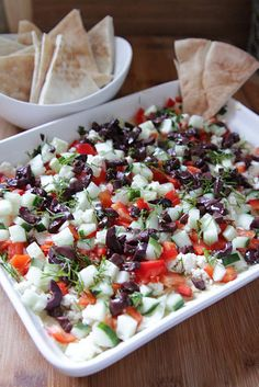 Greek Dip5 Layer Greek Dip  1. Finely chop olive, bell pepper, cucumber, and dill.  2. Spread hummus about 1-2 inches thick in the bottom of a wide serving dish.   3. Sprinkle the vegetables evenly over the hummus.   4. Crumble feta cheese on top.  5. Sprinkle bits of dill and serve with warm pita slices. Maybe add some artichokes.