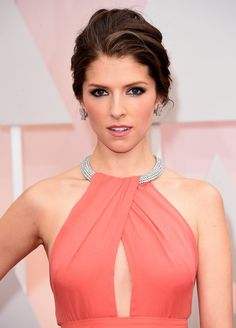 a romantic and classic updo on Anna Kendrick.