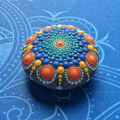 Jewel Drop Mandala Painted Stone painted by por ElspethMcLean