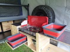 The new red collapsible tubs are great, two wash tubs are so much better than one.. wash in one, drain in the other. See how much useable bench space there is around the stove and sink.. this is what functionality means..