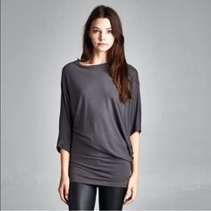 HP Semi loose fit asymmetrical top Round neck tunic. One sleeve is fitted and the other sleeve is wide dolman. Fitted at bottom Lewboutiquetwo Tops