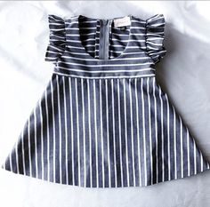 Let your babes take flight in this unique dress with ruffled sleeves, scoop neck bodice and A-line skirt in 3 unique fabrics, color combinations, and prints.  Handmade with love in Southern California.  Available in sizes 6 mos - 6 youth.  Please allow 2-3 weeks turn around time.  Care: d...