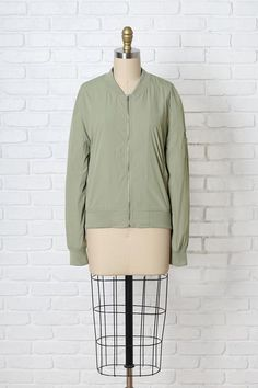 A bomber jacket is a must-have this spring season | Opt for this adorable sage green style | #bomberjacket #springfashion #spring2017