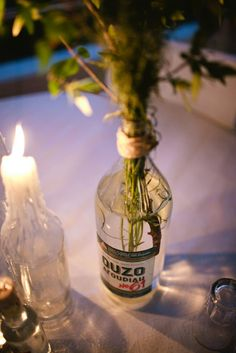 Greek wedding centerpieces with vintage ouzo bottles!