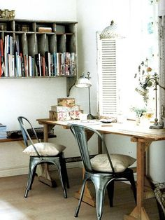 An office space for two - love the vintage divided wall shelf and the industrial chairs.