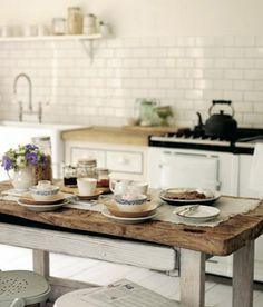 Simple kitchen and a quaint farm table. looks like a great morning to me!