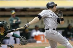 GAME 46: Saturday, May 26, 2012 - New York Yankees' Mark Teixeira follows through on a two-run single off of Oakland Athletics pitcher Bartolo Colon during the fifth inning of a baseball game in Oakland, Calif. (AP Photo/Jeff Chiu)
