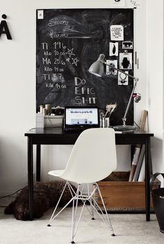 I love this study area with black desk, white chair and grey lamp