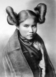 Hopi Girl . Traditional squash-blossom  hairstyle to signify their maturity and readiness for marriage.