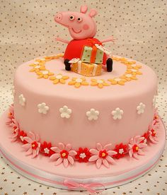 Peppa Pig cake. Bella loves Peppa Pig and now knows how to distinguish an English accent and does a great impression! She would love this cake :)