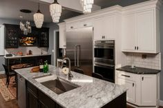 Kitchen designed by SEN Member Artisan Kitchens & Baths of Buffalo, NY, featuring Medallion Cabinetry. #kitchens #medallion