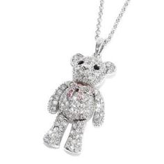 teddy bear Necklaces...I used to have one of these...until some1 took it back:(