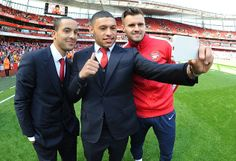 Selfie! Theo Walcott, Alex Oxlade-Chamberlain and Carl Jenkinson capture the moment