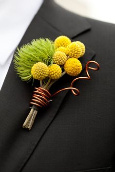 BITTY BUTTONS: I love this boutonniere ... The combination of the Billy Buttons and the wire is a great idea.