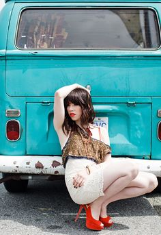 """Carly Rae Jepsen"" singer in front of early baywindow bus"