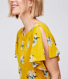 Split flutter sleeves are a fresh and femme twist for this soft top