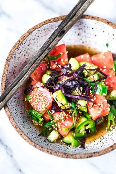 Watermelon Salad with Cucumber, Shiso, Sesame Seeds and Scallions - a light and refreshing Asian-style Watermelon Salad that is vegan, gluten-free and full of flavor! #watermelonsalad #shiso #shisorecipe #watermelon via @feastingathome