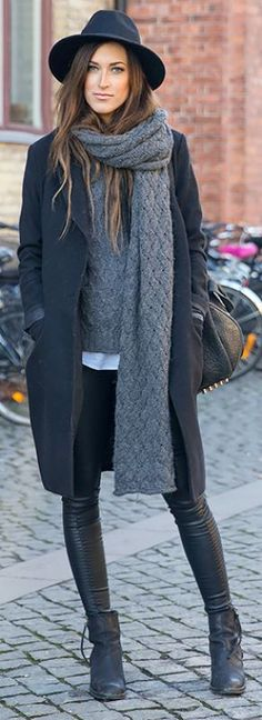 Leather leggings, oversized sweater, ankle boots, leather bag with grommets, edgy outfit, street style, wide brimmed hat, grey scarf, grey sweater, black wool coat, winter style