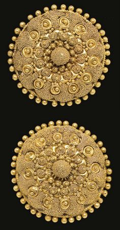 A PAIR OF ETRUSCAN GOLD DISKS   CIRCA LATE 4TH CENTURY B.C.   Each formed of domed sheet, encircled by granules, elaborately adorned in concentric rings, with clusters of granulation, filigree spirals centered by granules, clusters of granulation around larger granules, centered by a piriform knob embellished with granulation; mounted as earrings with modern gold backs and posts