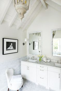 a clean color palette invites natural sunlight in this master bath. antique lantern hangs from the lofty ceiling. marble subway tile is from walker zanger.  by eleanor cummings (houston).  Ceiling would work for our bath!