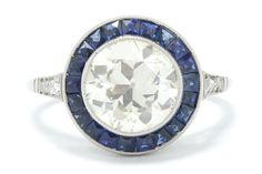 """The Irvine 2 Carat Art Deco Old European diamond target engagement ring is centered by an authentic, over 2 carat (2.38) antique diamond with the most charming character and bold size. This hand cut """"Romance Stone"""" glimmers with a captivating sparkle owing to it's larger and chunky facets which sparkles even under candle light. #diamond #sapphire #engagementring #haloring #targetring #love #ido #engagementrings #targetring #halorings #targetrings #2carat #2caratdiamond #artdeco #artdecoring Estate Engagement Ring, Antique Engagement Rings, Art Deco Ring, 2 Carat, Rose Cut Diamond, Blue Sapphire, Sparkles, Bracelet Watch, Jewels"""