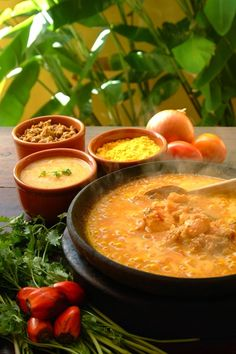 Moqueca...  seafood stew based on fish, onions, garlic, tomatoes, and cilantro.. brazilian food