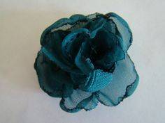 Finally, a fabric flower that looks pretty. 7 other flower tutorials at this website.