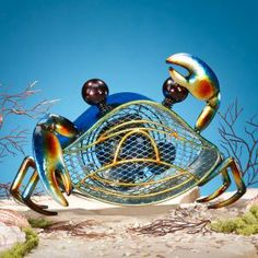 """Blue Crab ·          1 Speed Motor  ·          9.25"""" Tall x 13.5"""" Wide  ·          No Assembly Required  ·          4.5lbs  This snazzy little crab is no home decor lightweight. From his deep royal blue shell to those boldly waving claws, our Blue Crab figurine fan makes an eye-catching impression. As if his briny style and cast metal good looks weren't enough to win your heart, Blue Crab's single speed fan makes this canny crustacean a perfectly practical winner."""