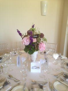 Vintage vases of flowers at Coombe Lodge www.bijouxfloral.co.uk