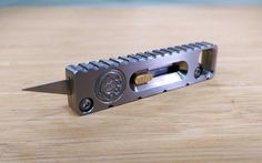 Roughly the size of a flash drive and made of Grade 5 titanium, Tactical Keychain's Titanium Utility Knife Keychain — or TUKK — is a solid addition to your EDC, at least if you periodically use small X-Acto style blades on the go. To expose the blade, push out and hold TUKK's brass button; when you're done, let go and the blade retracts automatically thanks to a magnetic retention system that also prevents it from coming out involuntarily in your pocket or pack…Learn More via GearHungry Edc Gadgets, Edc Everyday Carry, Edc Gear, Cool Knives, Knives And Swords, Knives And Tools, Edc Tools, Survival Tools, Survival Knife