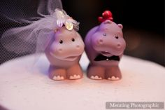 hippo cake toppers for a wedding cake are adorable