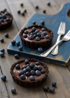 Brownie tarts topped with blueberries.