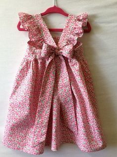 Flower Girl Dress Little Girl Dress Baby Girl Dress Roses***This dress can be made in any color youd like or with any of the fabrics you see in my shop.*** This sweet little dress is made of cotton in white with pink, blue or purple roses. Please add Kids Frocks, Frocks For Girls, Little Dresses, Little Girl Dresses, Flower Girl Dresses, Smocked Baby Dresses, Vintage Girls Dresses, Baby Dress Design, Baby Girl Dress Patterns