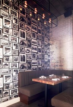 Pinewood-Social-Dining-Table-Nashville gallery wall on dark paint