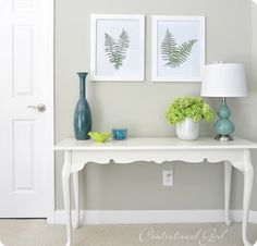 Sources: turquoise lamp from Lowe's; white vase from Crate + Barrel; oak console table given to me by my parents which I primed and painted white; teal vase from Marshalls; wall color is Ben Moore's 'Camouflage'; hydrangeas from my garden.
