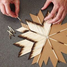 All you need is cardboard and glue and burnt matches