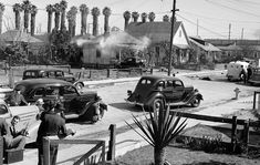 Feb. 17, 1938: Tear gas drifts from a home in the 1700 block of East 22nd Street as Los Angeles police trade gunfire with barricaded suspect George Farley