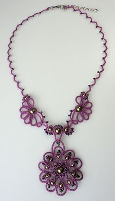 """Necklace tatted in purple with light green beads by yarnplayer, $66.00    Handmade tatted lace necklace with Swarovski Pearls and seed beads added while making.    The necklace measures about 16"""" (40 cm) long, plus 2 inches of extender chain for a total length of 18 inches.    I used """"Lizbeth"""" cotton thread in the color """"Country Grape"""", Swarovski Crystal Pearls in Light Green, and the technique of shuttle tatting. Tatting is a knotted form of handmade lace, so is very durable."""