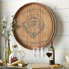 Wining and dining go hand in hand. So why not hang this barrel decor in your kitchen or dining room?  Accented by iron rivets and featuring French-inspired branding, it gives any wall a unique flavor—and proves that you've got great taste.