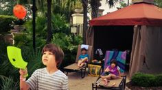Iden plays outside the cabana