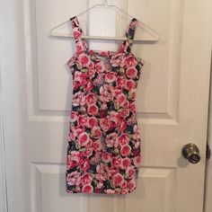 WINDSOR Mini Floral dress  never worn Mini floral dress. Cut outs on back. Size Small. 95%cotton 5% spandex. WINDSOR Dresses Mini