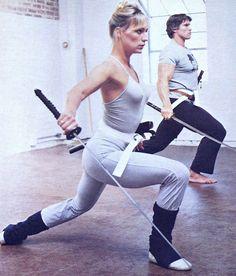 Sandahl Bergman and Arnold Schwarzenegger training for Conan the Barbarian (1982).