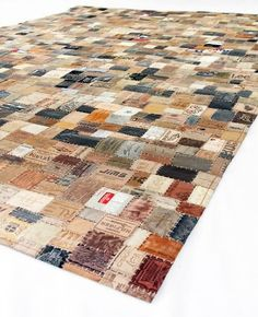 Hunter Leather Rug by Joanne Crocker | Trash Garden is a patchwork of reclaimed leather labels. The result is a stunning graphic rug!